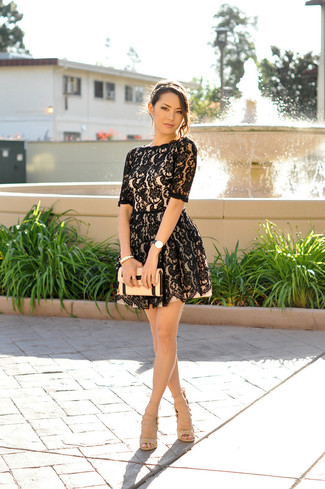 For a nothing less than drool-worthy ensemble, marry a black lace fit and flare dress with a headband. Round off this outfit with beige leather heeled sandals. You're sure to always look great even despite the unbearable heat if you have this outfit as your go-to formula.