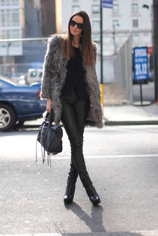 Wear a cardigan and black leather slim pants for a sleek elegant look. A pair of black leather ankle boots will seamlessly integrate within a variety of outfits.