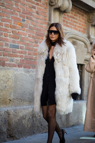 How to wear: white fur coat, black chunky cardigan, black lace tank dress, black suede pumps