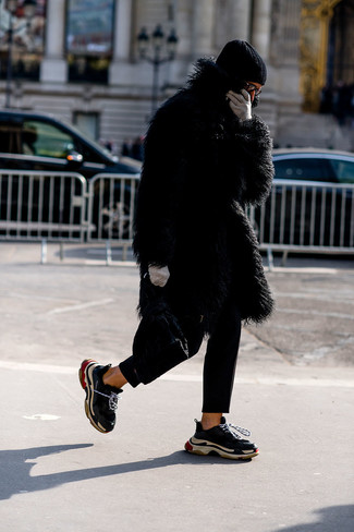How to wear: black fur coat, black chinos, black athletic shoes, black beanie