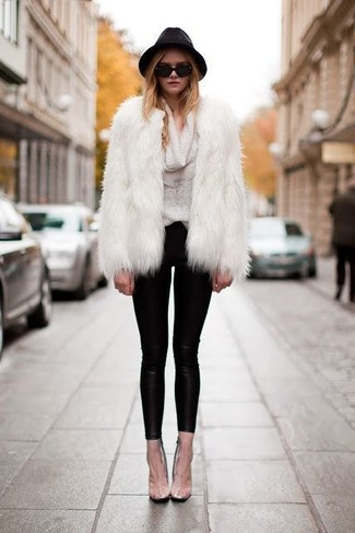 For a nothing less than drool-worthy getup, wear a white fur coat with a black hat. When staying inside on a chilly winter day is not a possibility, this ensemble just might get you through the day.