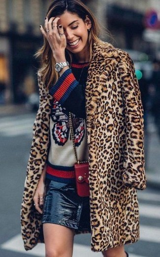 How to wear: tan leopard fur coat, navy print crew-neck sweater, black leather button skirt, red leather crossbody bag
