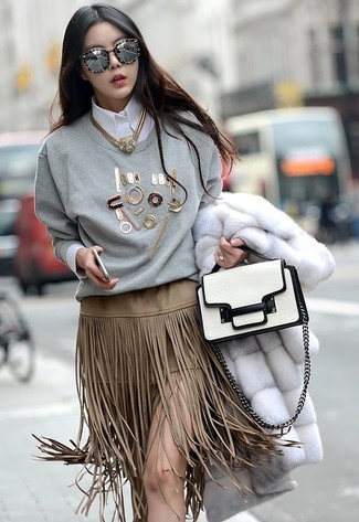 How to wear: white fur coat, grey embellished crew-neck sweater, white dress shirt, beige fringe suede pencil skirt