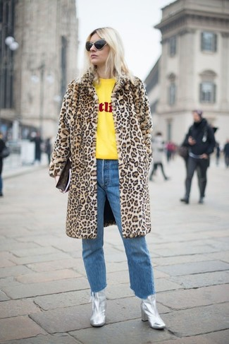 How to wear: tan leopard fur coat, yellow print crew-neck sweater, blue jeans, silver leather ankle boots