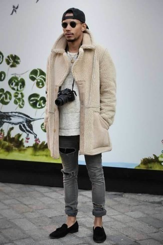 How to Wear Grey Ripped Jeans For Men: This bold casual combination of a beige fur coat and grey ripped jeans is extremely easy to put together without a second thought, helping you look seriously stylish and prepared for anything without spending too much time searching through your wardrobe. Unimpressed with this look? Introduce a pair of black suede tassel loafers to mix things up a bit.