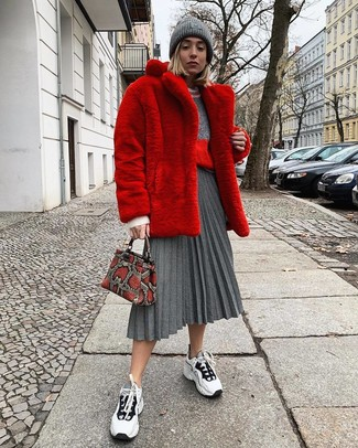 How to wear: red fur coat, grey crew-neck sweater, grey pleated midi skirt, white and black athletic shoes