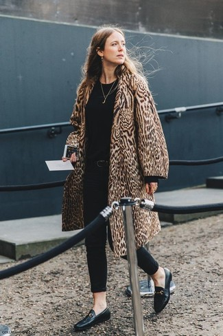How to wear: tan leopard fur coat, black crew-neck sweater, black skinny jeans, black leather loafers