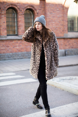 How to wear: tan leopard fur coat, black crew-neck sweater, black skinny jeans, black leather ankle boots
