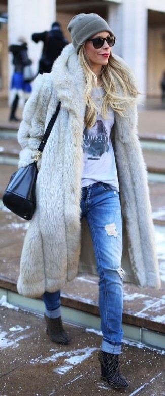How to wear: grey fur coat, white and black print crew-neck t-shirt, blue ripped boyfriend jeans, navy studded suede ankle boots
