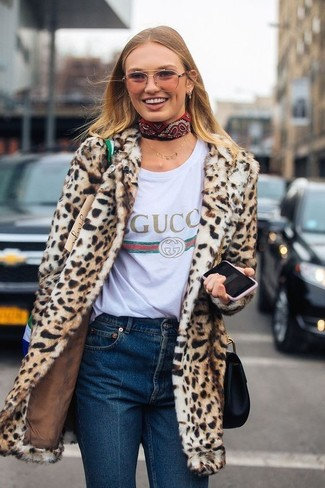 How to wear: tan leopard fur coat, white print crew-neck t-shirt, navy jeans, black leather crossbody bag