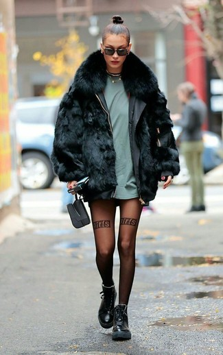 How to wear: black fur coat, mint crew-neck t-shirt, black leather lace-up flat boots, black sunglasses