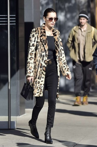 How to wear: tan leopard fur coat, black crew-neck t-shirt, black skinny pants, black leather lace-up ankle boots