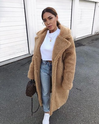 How to wear: tan fur coat, white cropped top, light blue jeans, white athletic shoes