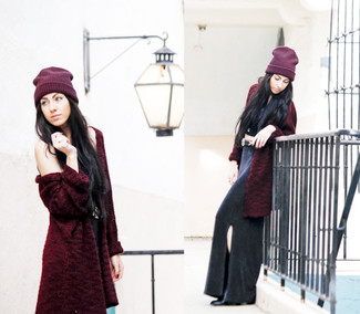 How to Wear a Black Slit Maxi Skirt: Why not dress in a burgundy fur coat and a black slit maxi skirt? These two items are totally functional and look fabulous when combined together. Let your outfit coordination sensibilities truly shine by complementing your look with a pair of black leather ankle boots.