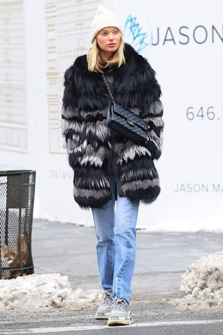 How to wear: black fur coat, light blue jeans, grey athletic shoes, black quilted leather satchel bag