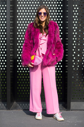 How to wear: hot pink fur coat, pink jumpsuit, white leather low top sneakers, pink leather clutch