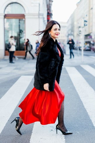 How to wear: black fur coat, red satin maxi dress, black leather pumps, silver earrings