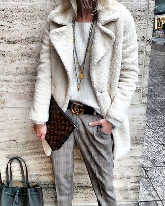 How to wear: white fur coat, white oversized sweater, grey plaid dress pants, dark brown print leather clutch