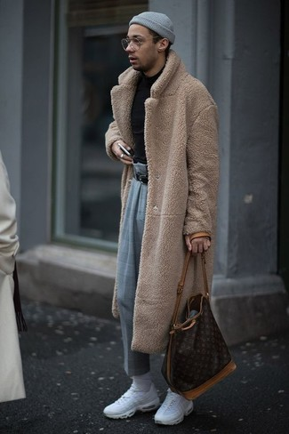 Nail that dapper look with a tan fur coat and a grey beanie. Add a more relaxed twist to your outfit with white athletic shoes. Be sure that this getup won't let you down when it's so damn cold.