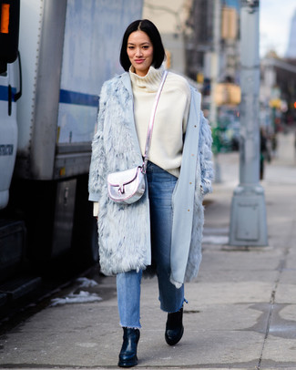 e112a9eea930 How to wear: light blue fur coat, white wool turtleneck, blue fringe jeans