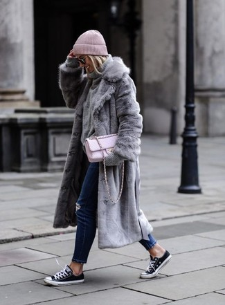 How to wear: grey fur coat, grey wool turtleneck, navy ripped jeans, black and white canvas low top sneakers