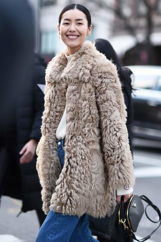 How to wear: beige fur coat, white turtleneck, blue jeans, black leather crossbody bag