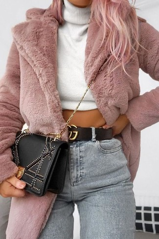 How to wear: pink fur coat, white knit turtleneck, grey skinny jeans, black embellished crossbody bag