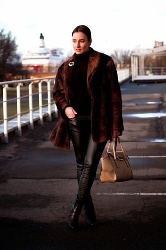 Marry a dark brown fur coat with black leather slim pants if you're going for a neat, stylish look. Finish off your look with black leather booties.