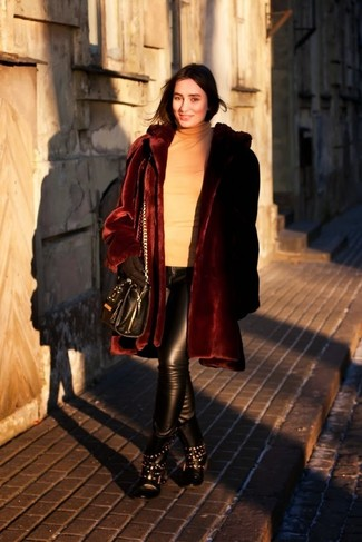 How to wear: burgundy fur coat, tan turtleneck, black leather skinny pants, black studded leather lace-up flat boots