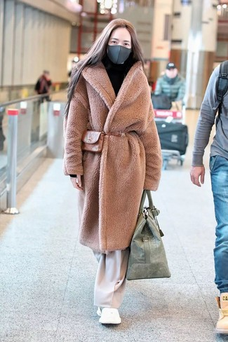 How to wear: tan fur coat, beige wide leg pants, white athletic shoes, tan leather fanny pack