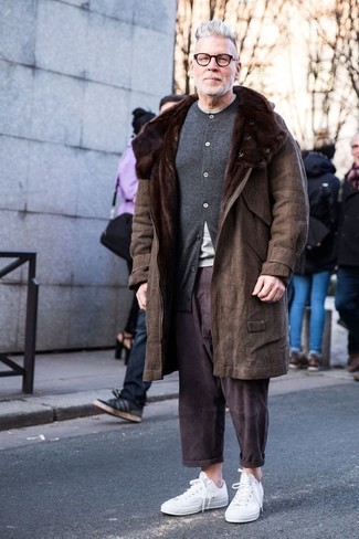 How to Wear a Brown Coat For Men: For a look that's effortlessly sleek and envy-worthy, consider pairing a brown coat with dark brown chinos. Our favorite of a countless number of ways to finish this ensemble is with white low top sneakers.