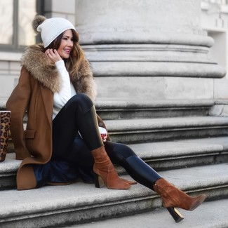 White Crew-neck Sweater Outfits For Women: Opt for a white crew-neck sweater and black leather leggings for both chic and easy-to-create ensemble. You can get a little creative in the footwear department and spruce up this outfit by finishing with brown suede ankle boots.