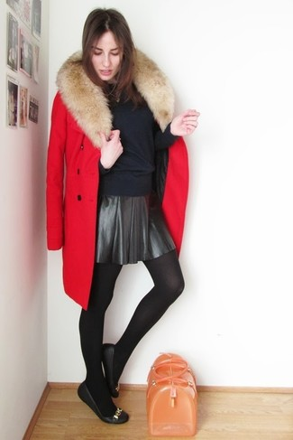 This combination of a dark blue crew-neck sweater and a black leather skater skirt spells comfort and style. A pair of black leather ballerina shoes will be a welcome addition to your getup. You can be sure this look is great for fluctuating autumn weather.
