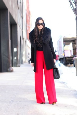 Black Crew-neck Sweater Dressy Outfits For Women: This off-duty pairing of a black crew-neck sweater and red wide leg pants can go different ways depending on the way it's styled. On the fence about how to round off? Introduce tan leopard suede pumps to the mix to step up the fashion factor.