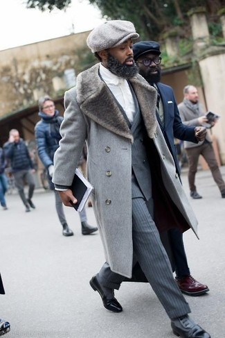 A grey fur collar coat and striped trousers are great essentials to incorporate into your current wardrobe. Black leather derby shoes will add some edge to an otherwise classic look.