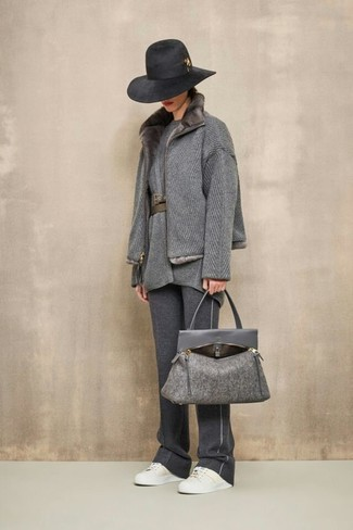 How to Wear a Grey Fur Collar Coat: Perfect the effortlessly chic outfit in a grey fur collar coat and charcoal sweatpants. Complete your ensemble with a pair of white leather low top sneakers to keep the look fresh.