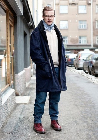 Men's Looks & Outfits: What To Wear In Winter: For a casually sleek outfit, choose a navy fur collar coat and blue jeans — these two pieces go perfectly well together. Burgundy leather casual boots are a stylish companion for your ensemble. In the winter months, when functionality is above all, it can be easy to settle for a less-than-stylish look in the name of convenience. This look, however, is a practical illustration that you can actually stay snug and remain equally stylish during the winter months.