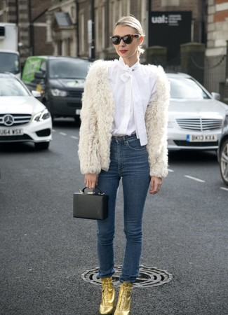 How to wear: white fur jacket, white button down blouse, navy skinny jeans, gold leather lace-up ankle boots