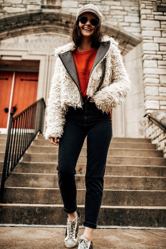 Flat Cap Outfits For Women: A white fur jacket and a flat cap are the kind of stylish casual essentials that you can wear for years to come. Let your sartorial prowess truly shine by rounding off your outfit with tan leopard low top sneakers.