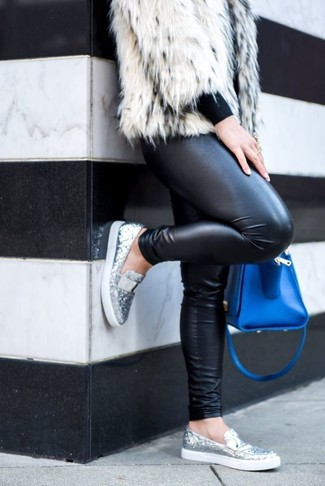 How to Wear a Blue Leather Satchel Bag: Opt for a white fur jacket and a blue leather satchel bag for an incredibly chic ensemble that's easy to put together. And if you need to effortlesslly amp up this getup with footwear, complement this ensemble with a pair of silver sequin loafers.