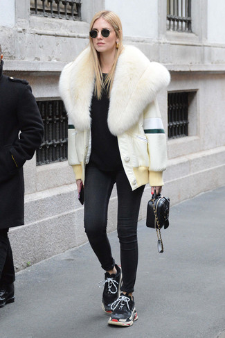 How to wear: white fur jacket, black crew-neck sweater, black skinny jeans, black athletic shoes