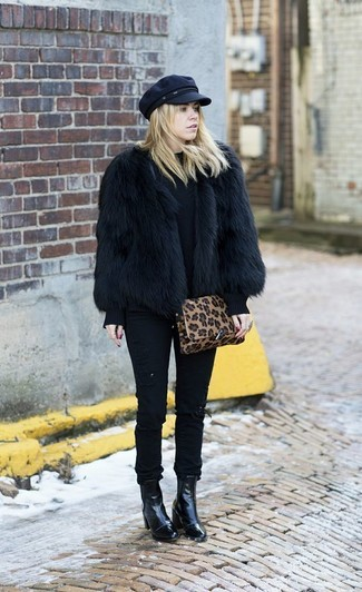 How to wear: black fur jacket, black crew-neck sweater, black skinny jeans, black leather ankle boots