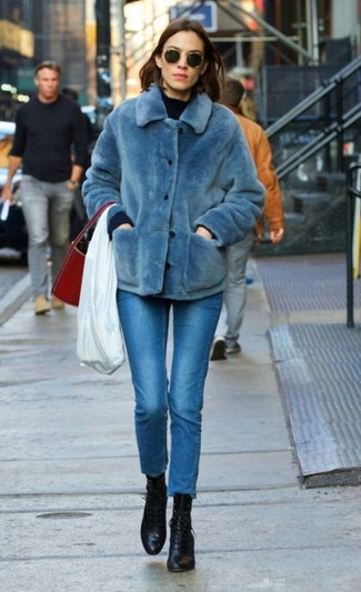 How to wear: blue fur jacket, navy crew-neck sweater, blue skinny jeans, black leather lace-up ankle boots