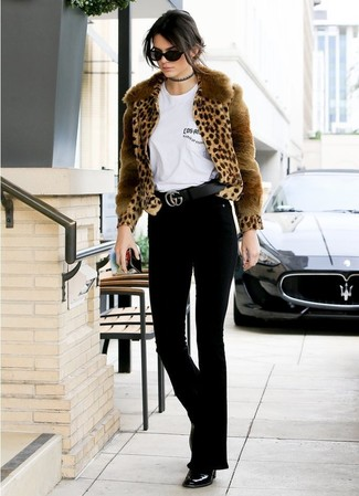 How to wear: tan leopard fur jacket, white crew-neck t-shirt, black flare jeans, black leather ankle boots