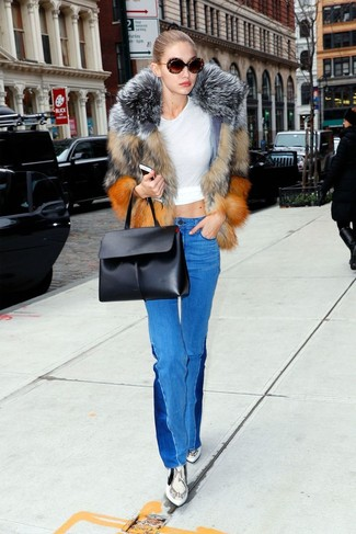 How to wear: brown fur jacket, white crew-neck t-shirt, blue flare jeans, grey snake leather ankle boots