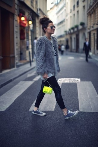 Consider pairing a grey fur jacket with charcoal sunglasses to steal the show. Grey low top sneakers are the right shoes here to get you noticed. As the temperature drops, you'll discover that an outfit like this is perfect for this time.