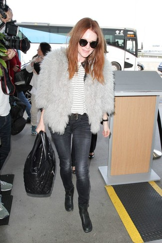 How to wear: grey fur jacket, white horizontal striped crew-neck t-shirt, charcoal skinny jeans, black leather ankle boots