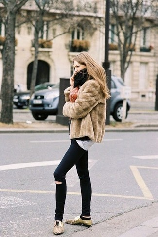 Pair a tan fur jacket with black ripped slim jeans for a casual level of dress. This outfit is complemented perfectly with camel embellished leather oxford shoes.