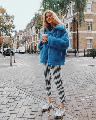 How to wear: blue fur jacket, black crew-neck t-shirt, black and white vertical striped skinny pants, white low top sneakers