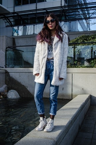 How to Wear a White Lace Cropped Top: A white lace cropped top and blue boyfriend jeans are a great getup to integrate into your day-to-day off-duty rotation. The whole look comes together perfectly when you complete your look with a pair of white high top sneakers.
